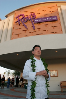 Roy Yamaguchi in front of his Chandler Restaurant